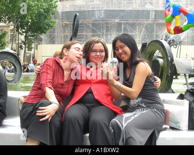 image no 2 of three female students taking digital picture in front of Tinguely fountain at Place Igor Stravinsky - Stock Photo
