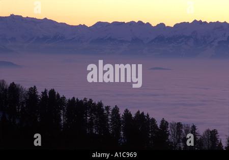 Fog over River Rhine valley and Lake Constance from Pfaender Mountain, Bregenz Vorarlberg Austria - Stock Photo