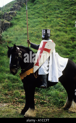 Historical Re-enactment, Crusader Knight, early Medieval period, horseback, red cross, shield, sword, weapons, weaponry, - Stock Photo