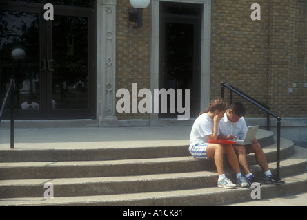 Studying Together on School Steps - Stock Photo