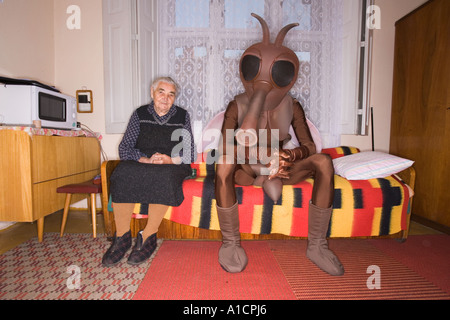 ... Old woman and a tall man in mosquito costume sitting on the bed - Stock Photo & Tall man in brown mosquito costume getting up from bed Stock Photo ...