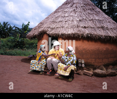 White woman making friends in africa - Stock Photo