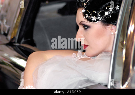 Young Bride in a Car - Stock Photo