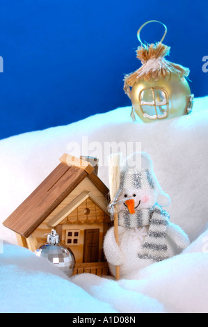 Christmas Still Life Snowman near a cottage house xmas tree decorations Real estate housing concept - Stock Photo