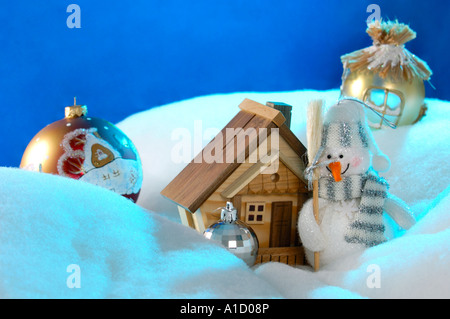 Artistic Christmas Still Life Snowman near a house Xmas decoration - Stock Photo
