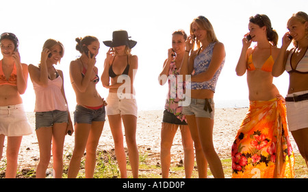 Eight Caucasian Teen Girls Talking on Cellphones at Hunting Island Beach USA, Communications and Vacation - Stock Photo