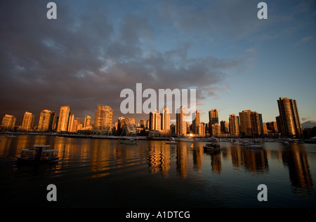 Sunrise over False Creek, Vancouver, British Columbia, Canada after days of record snow showers. November 28th 2006. - Stock Photo
