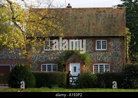 Traditional English brick and flint cottage in the Chilterns Oxfordshire United Kingdom - Stock Photo