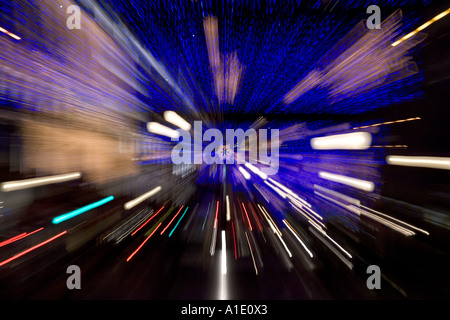 Blurred image of Christmas lights decorations and traffic in Regent Street London United Kingdom - Stock Photo