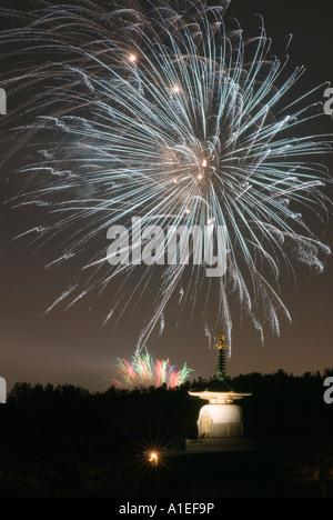 Central Milton Keynes firework display over the city of Milton Keynes Buddhist Peace Pagoda on Guy Forks night 5th - Stock Photo