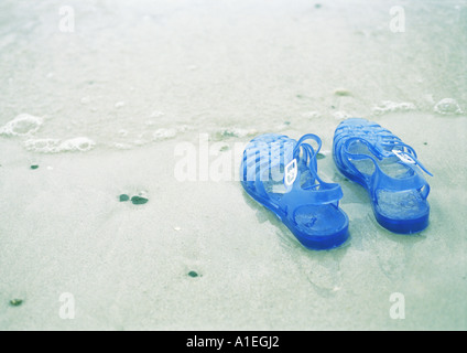 Jelly shoes on beach - Stock Photo