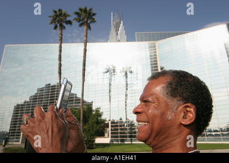 California Orange County Garden Grove Crystal Cathedral Black male visitor digital camera - Stock Photo