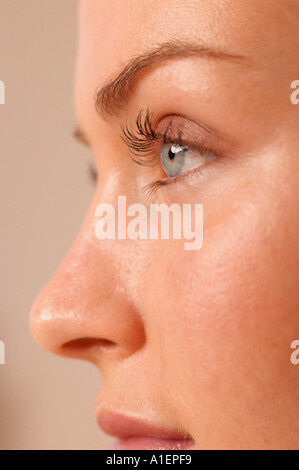 Partial profile of female face - Stock Photo