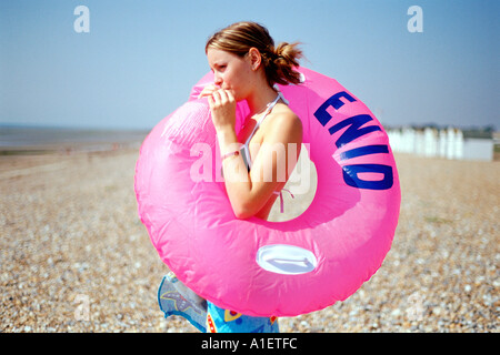 Girl on the beach with inflatable lifebelt - Stock Photo