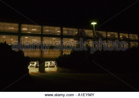 Cars parked in a parking lot at night - Stock Photo