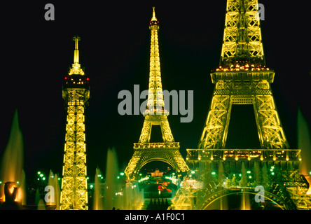 Montage of the Eiffel Tower with bright lights at night Paris France - Stock Photo