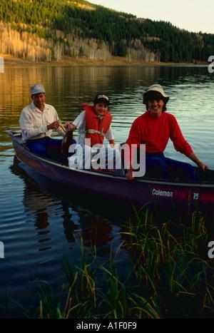 Family in a canoe on a Colorado lake - Stock Photo