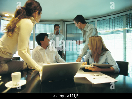 Businesspeople working in conference room