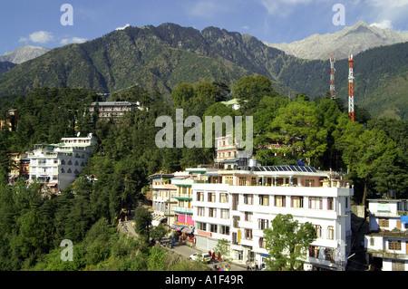 View of McLeod Ganj and Dhauladhar range of Indian Himalaya form Namgyal monastery - Stock Photo
