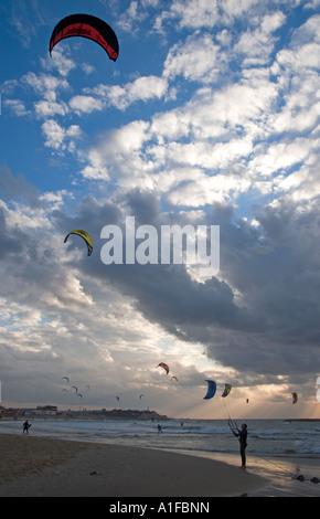 A kite boarder pulls a power kite in the Mediterranean Sea Tel Aviv Israel - Stock Photo