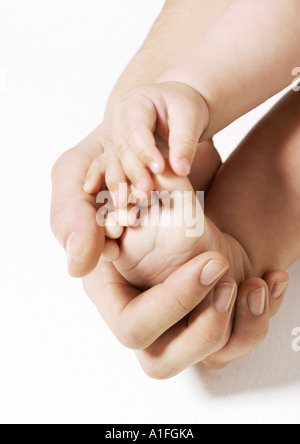 Woman holding baby's foot - Stock Photo
