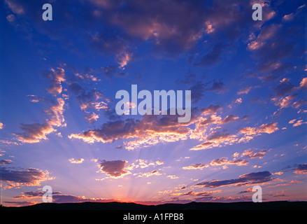 Rays of light through sunset clouds Near the Steens Mountain Oregon - Stock Photo