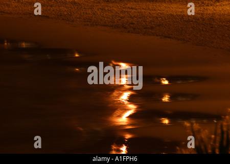 light reflected across water Kings Beach SUNSHINE COAST QUEENSLAND AUSTRALIA - Stock Photo