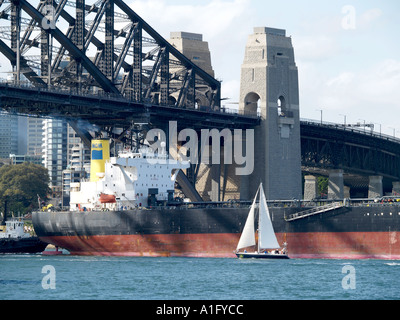SHIP CALLED PACIFIC AQUARIUS PASSING OTHER CRAFT UNDER HARBOUR BRIDGE SYDNEY NEW SOUTH WALES AUSTRALIA - Stock Photo