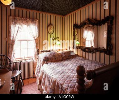 Bedroom in the 1770 s House famous upmarket inn on Main Street East Hampton Long Island NY - Stock Photo