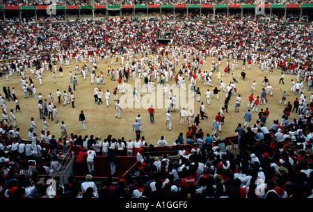 Crowd in Plaza de Toros after the end of running of the bulls encierro Sanfermines festival Pamplona Navarra Spain - Stock Photo