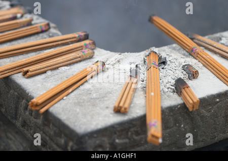 incense sticks burning on huge urn in the Buddhist jing an temple in shanghai jing an temple has been recently 2004 - Stock Photo