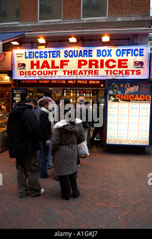 People queuing for discounted west end theatre tickets, Leicester square, London, uk - Stock Photo