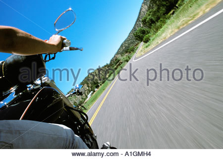 Passenger's view of a motorcycle speeding on a freeway. - Stock Photo