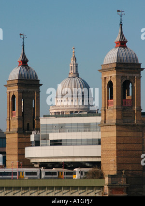 The dome of St Paul's Cathedral framed by the twin brick towers of Cannon Street Station - Stock Photo