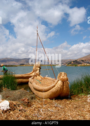 Reed boat moored on one of the floating islands of  Uros on Lake Titicaca - Stock Photo