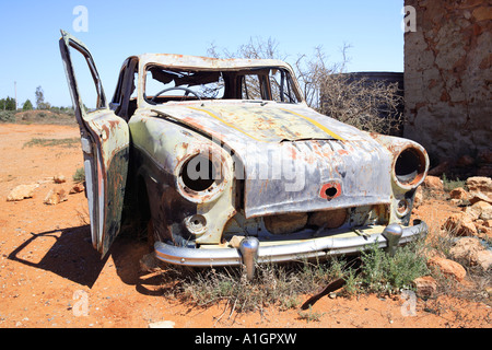 Derelict car next to old water tank and ruins, Silverton near Broken, Hill New South Wales, Australia - Stock Photo