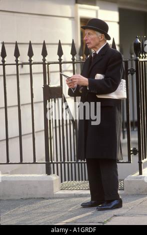 City gentleman gent in traditional bowler hat Belgravia London Circa 1980s HOMER SYKES - Stock Photo