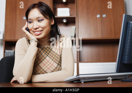 Close-up of a businesswoman using a mobile phone - Stock Photo