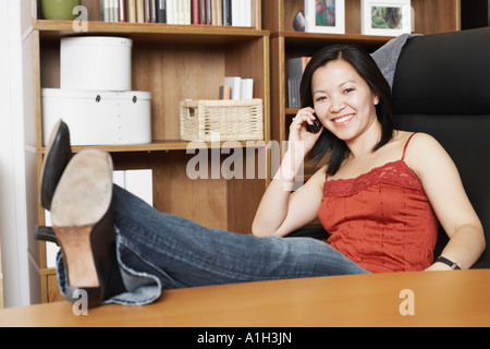 Portrait of a businesswoman using a mobile phone - Stock Photo