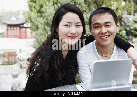 Portrait of a young couple smiling - Stock Photo