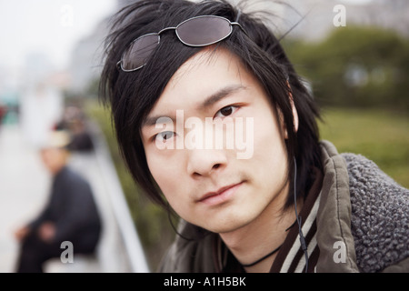 Portrait of a young man looking serious - Stock Photo