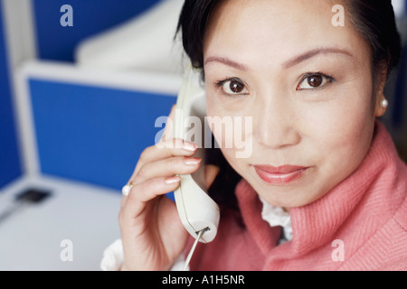 Portrait of a businesswoman talking on the telephone - Stock Photo