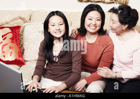 Portrait of a girl sitting with her mother and her grandmother