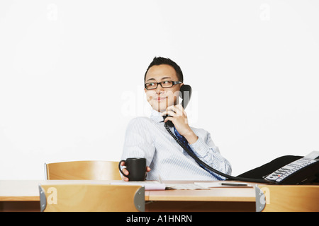 Close-up of a businessman talking on the telephone - Stock Photo