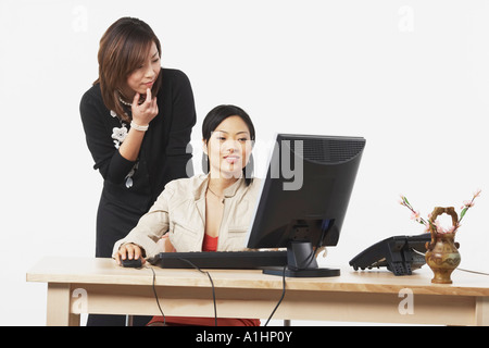Two businesswomen looking at a computer Stock Photo