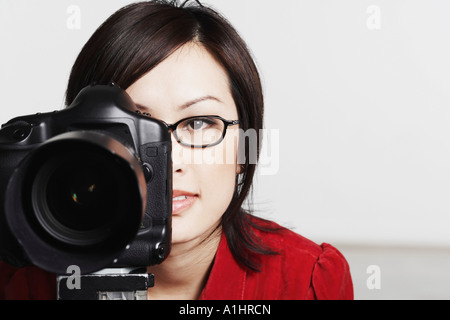 Close-up of a young woman taking a photograph Stock Photo