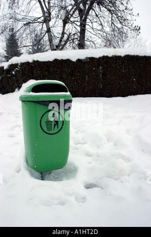 Bin in the snow in alps france  - Stock Photo