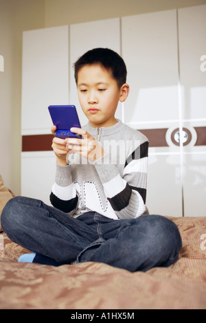 Boy playing a video game - Stock Photo