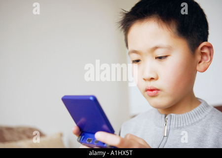 Close-up of a boy playing a video game - Stock Photo
