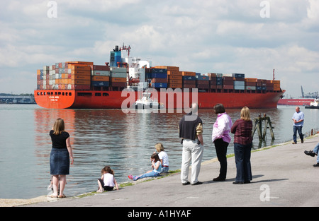 Container ship Lykes Hero docking at Southampton with people in the foreground - Stock Photo